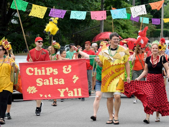 A parade kicks off the 14th annual Tomato Art Fest in East Nashville on Saturday, August 12, 2017.