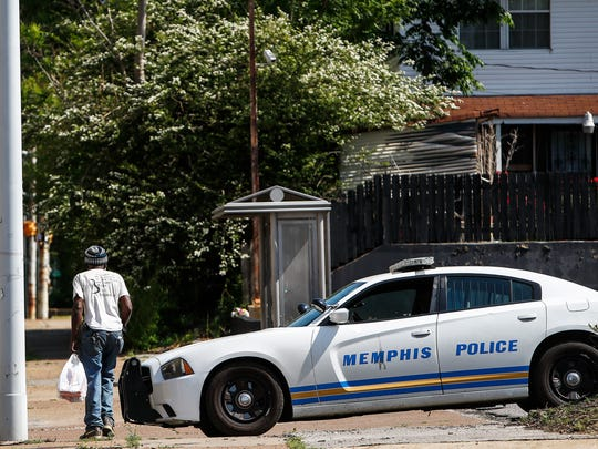 A Memphis police unit sits at the corner of N. Watkins St. and Galloway Ave. Tuesday morning, where six young men and teens riding in the same car were shot at Sunday night. Two victims, Dejuan Hill and Deandre Rogers, both 18 years old, were killed during the incident. Two of the wounded were released from the hospital Monday, but others including a 14-year-old remained hospitalized.