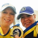 BethAnn Perkins, of Grand Ledge, and her best friend, Kelly Luckett, after finishing their fourth Boston Marathon together Monday. Perkins ran the race as Luckett's guide.
