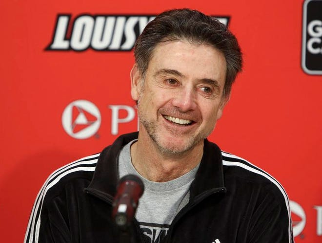 A shaggy Rick Pitino answers questions Monday before the Cards host USF.