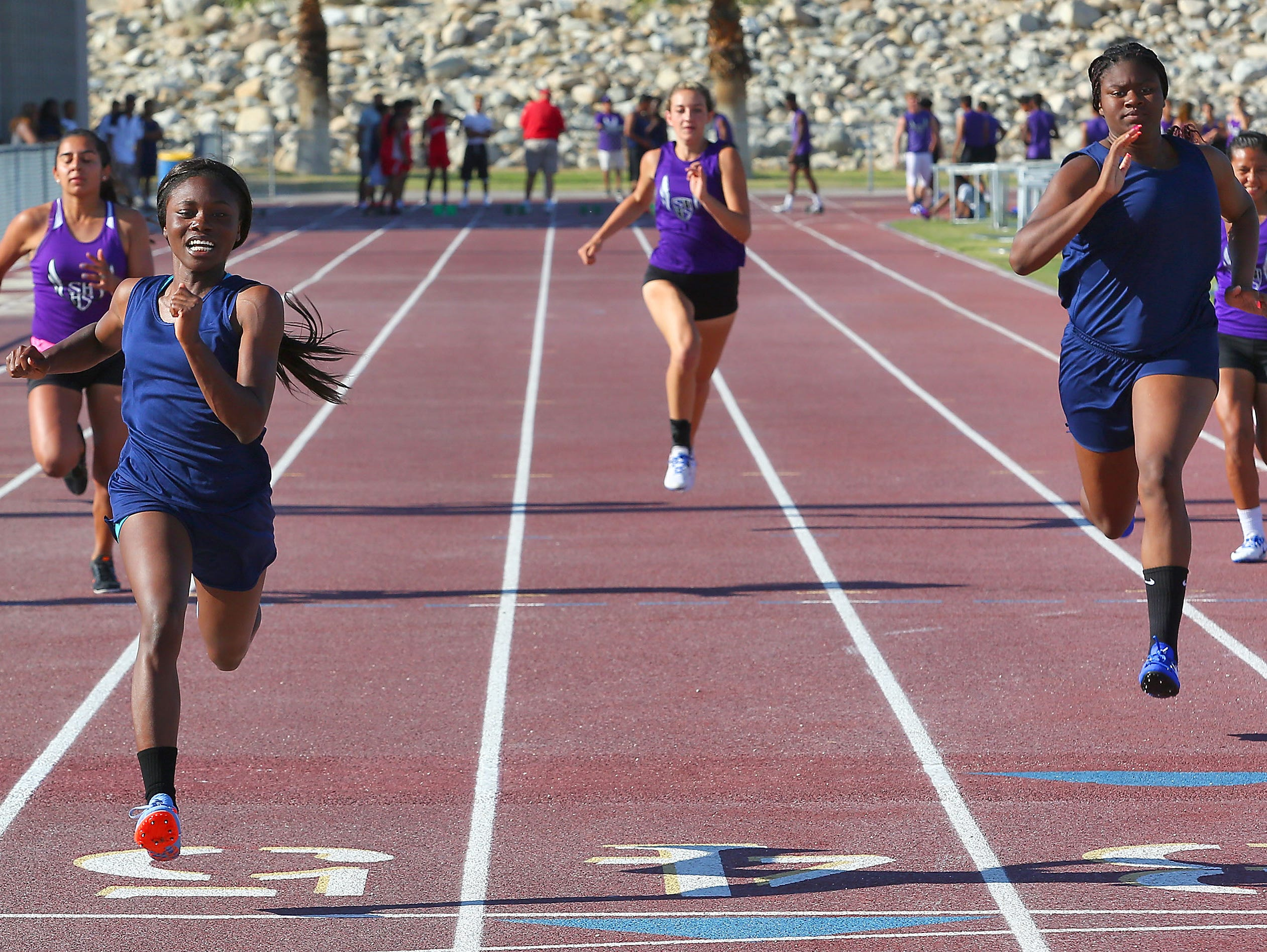 Nykaya Botley wins her heat in the 100 meter at Desert Hot Springs High School, April 13, 2016.
