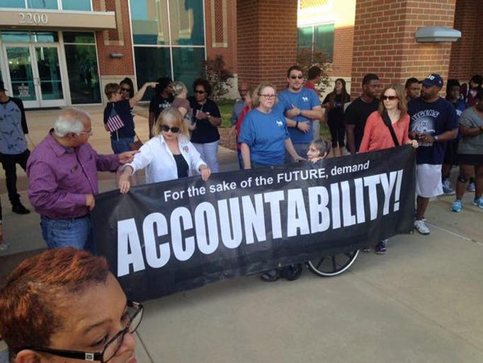 Protesters rallied outside McKinney police headquarters