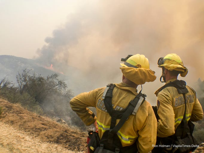 Firefighters work the Rough Fire along Highway 180