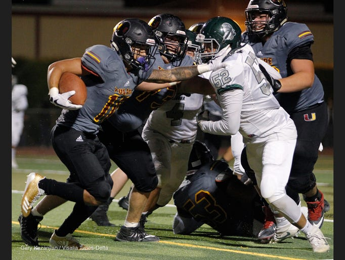 Tulare Union's Kazmeir Allen scampers for a long gain