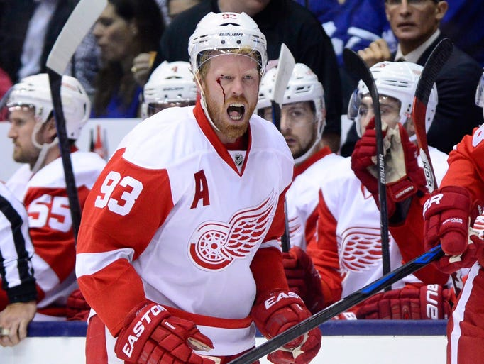 Johan Franzen yells at the referee after taking a hit