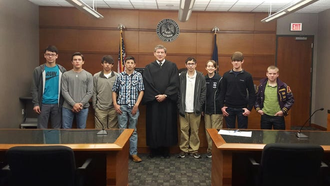 Judge Parker Self, district judge with the 26th Judicial District Court, visited with the students to explain to them the judicial process, including showing how the video arraignment process is conducted.