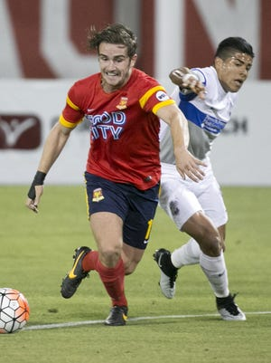 Arizona United midfielder Luke Rooney fights for a loose ball against Colorado Springs Switchbacks FC's Rony Argueta during the first half of the USL soccer match at the Peoria Sports Complex on Saturday, May 21, 2016. Switchbacks FC won the match 3-1.