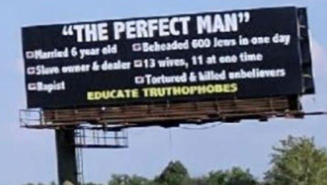 This photo of a billboard that insults the prophet Mohammed was taken Friday, June 2, 2017, on Interstate 465 south in Indianapolis.