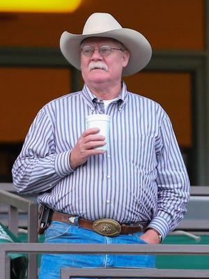 California Chrome owner Steve Coburn is shown watching his horse workout at Belmont Park prior to the Belmont Stakes. Coburn is upset that his horse was beaten Saturday by a field that was fresher than his and didn't run in all three Triple Crown races.