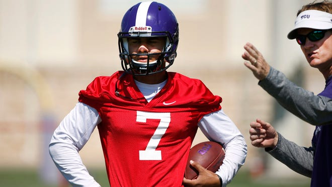 TCU quarterback Kenny Hill (7) is given direction by co-offensive coordinator and quarterbacks coach Sonny Cumbie during a team practice Friday, Aug. 5, 2016, in Fort Worth, Texas. Hill is the starting quarterback for the 13th-ranked Horned Frogs. (Ron Jenkins/Star-Telegram via AP)