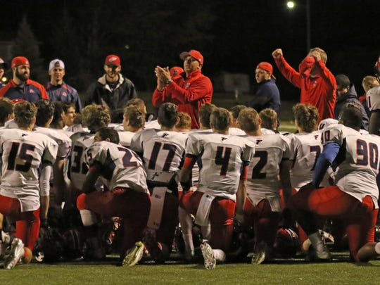 Franklin's football team comes together following Friday's playoffs-clinching win over Royal Oak.