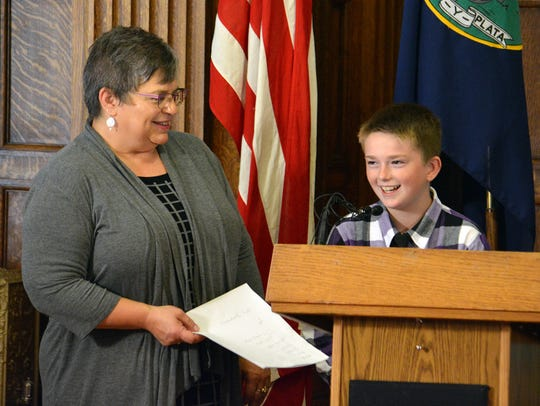Ethan Martin, 12, and his mom, Novelene talk about