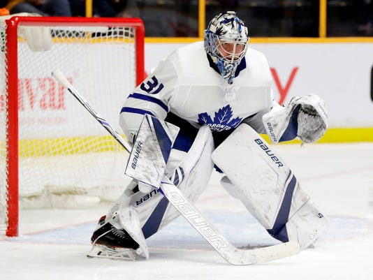FILE - In this March 22, 2018, file photo, Toronto Maple Leafs goaltender Frederik Andersen plays against the Nashville Predators in the second period of an NHL hockey game, in Nashville, Tenn. Toronto goalie Frederik Andersen and Boston counterpart Tuukka Rask have near identical save percentages at .918 and .917, respectively. Game 1 of the Bruins and Toronto Maple Leafs first round playoff series is Thursday, April 12, 2018. (AP Photo/Mark Humphrey, File)