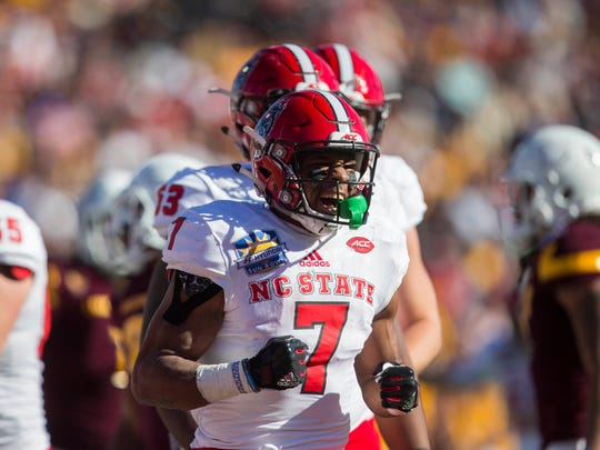 North Carolina State Wolfpack running back Nyheim Hines (7) celebrates after scoring a touchdown against the Arizona State Sun Devils defense in the 2017 Sun Bowl at Sun Bowl Stadium.