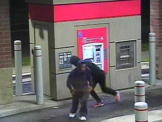SUSPECTS GATHERING MONEY AND LEAVING