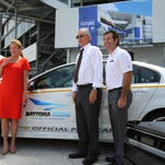 From left, General Motors president Alan Batey; International Speedway Corp. CEO Lesa France Kennedy; NASCAR executive vice president Jim France, and Daytona International Speedway president Joie Chitwood III pose for a group photo during the announcement that Chevrolet will become a partner in the Daytona Uprising expansion project in Daytona Beach, Fla., Wednesday.
