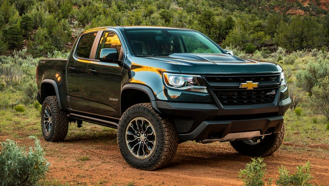 This update photo provided by Chevrolet shows the new 2018 Chevrolet Colorado ZR2. Full-size trucks such as the Chevrolet Silverado and Ford F-150 are hugely popular. But not everyone needs that much capability from a new pickup.  Chevrolet's smart-looking Colorado is easy to drive every day. We like its simple but easy-to-use interior and many of its available technology features upgrades.