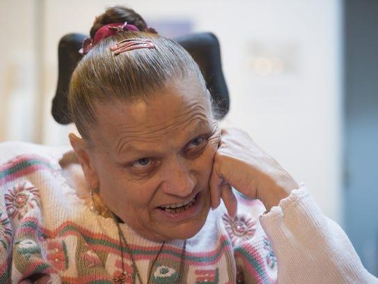 Sherri Kaspar sits in her home in Kersey on Thursday,