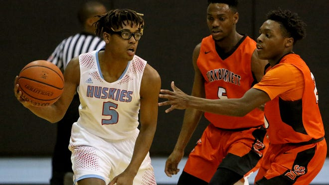 Hirschi's Rashad Green passes as Burkburnett's Kendarius Horton attempts to get a hand on the ball Tuesday, Feb. 6, 2018, at Hirschi. The Huskies defeated the Bulldogs 59-43.