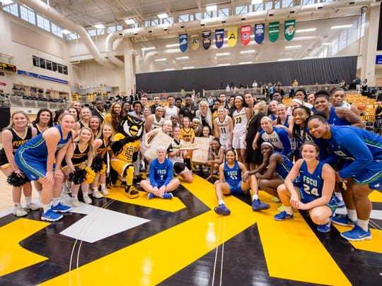 Members of the Kennesaw State and FGCU basketball teams celebrate with 8-year-old Cate Zavitz for her birthday..
