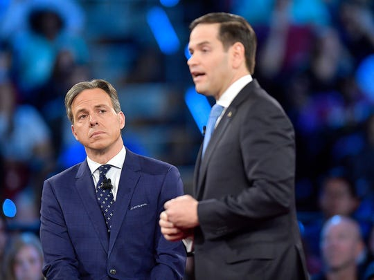 CNN's Jake Tapper listens to Republican Sen. Marco Rubio during a CNN town hall meeting, Wednesday, Feb. 21, 2018, in Sunrise, Fla. Rubio is being challenged by angry students, teachers and parents who are demanding stronger gun-control measures after a school shooting that killed more than a dozen people at a Florida high school.