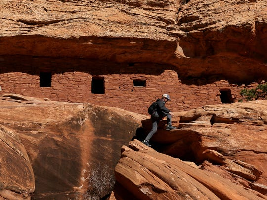 A hiker explores The Citadel, an ancient ruin within the Bears Ears National Monument, in southern Utah in November of 2017.
