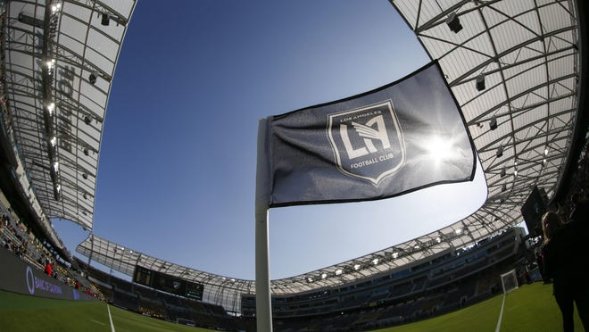 FILE - In this April 29, 2018 file photo taken with a fisheye lens, a flag flies at the Banc of California Stadium prior to an MLS soccer game between Los Angeles FC and the Seattle Sounders in Los Angeles.