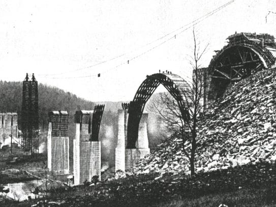 Construction work continues on the bridge's arches,