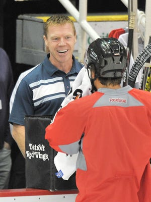 """Red Wings special assistant to the general manager and """"Grind Line"""" member Kris Draper pops in to say hello to some of the players during practice."""