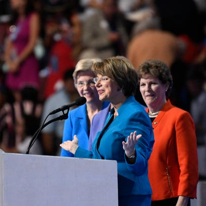 Sen. Amy Klobuchar, D-Minn., flanked by other Democratic senators, speaks during the 2016 Democratic National Convention at the Wells Fargo Center in Philadelphia.