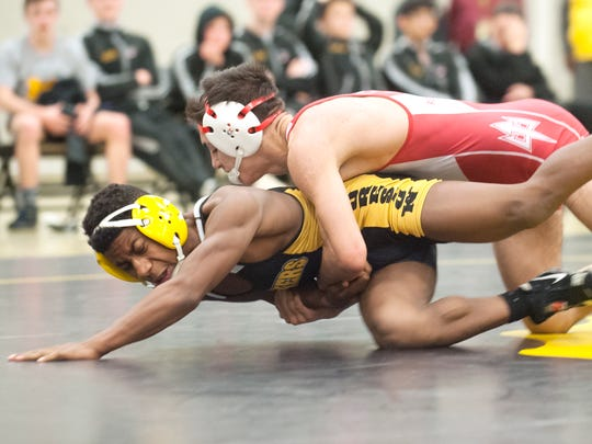 Rancocas Valley's Nieko Malone, top, takes down Moorestown's Ronald McCoy during the 126 lb. bout of Wednesdays wrestling match held at Moorestown High School.  Malone won, 8-2.