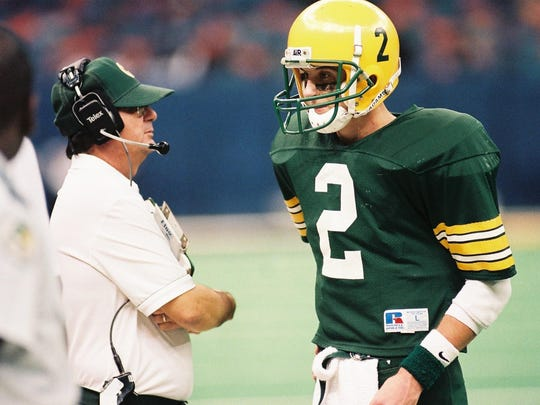 Cecilia High quarterback Rusty Berard (2) talks strategy with head coach James Waguespack on the sidelines during the 1995 3A state title game.