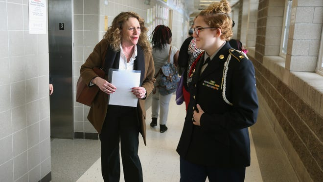 Barbara Deane-Williams, RCSD superintendent, is greeted by Jr. ROTC cadet, 10th-grader Alexis Dygert, who escorted her to a meeting at Rochester Early College International High School.