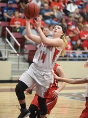 Norfork's Kinley Stowers goes up for two against Rural
