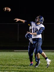 Brookfield Academy quarterback Ian Francis (12) throws