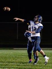 Brookfield Academy quarterback Ian Francis (12) throws