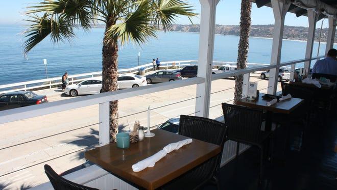 The patio seating at Brockton Villa offers sweeping views of La Jolla Cove.
