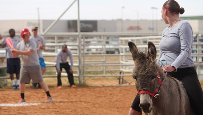 The Otero County Sheriff's Department and Holloman Air Force Base's firefighters competed against each other in a donkey baseball game on Saturday afternoon. The event was hosted by the Optimist Club of Alamogordo and raised funds for their youth programs.