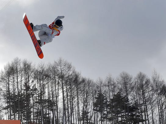 Kelly Clark, of the United States, jumps during the women's halfpipe qualifying at Phoenix Snow Park at the 2018 Winter Olympics in Pyeongchang, South Korea, Monday, Feb. 12, 2018. (AP Photo/Kin Cheung)
