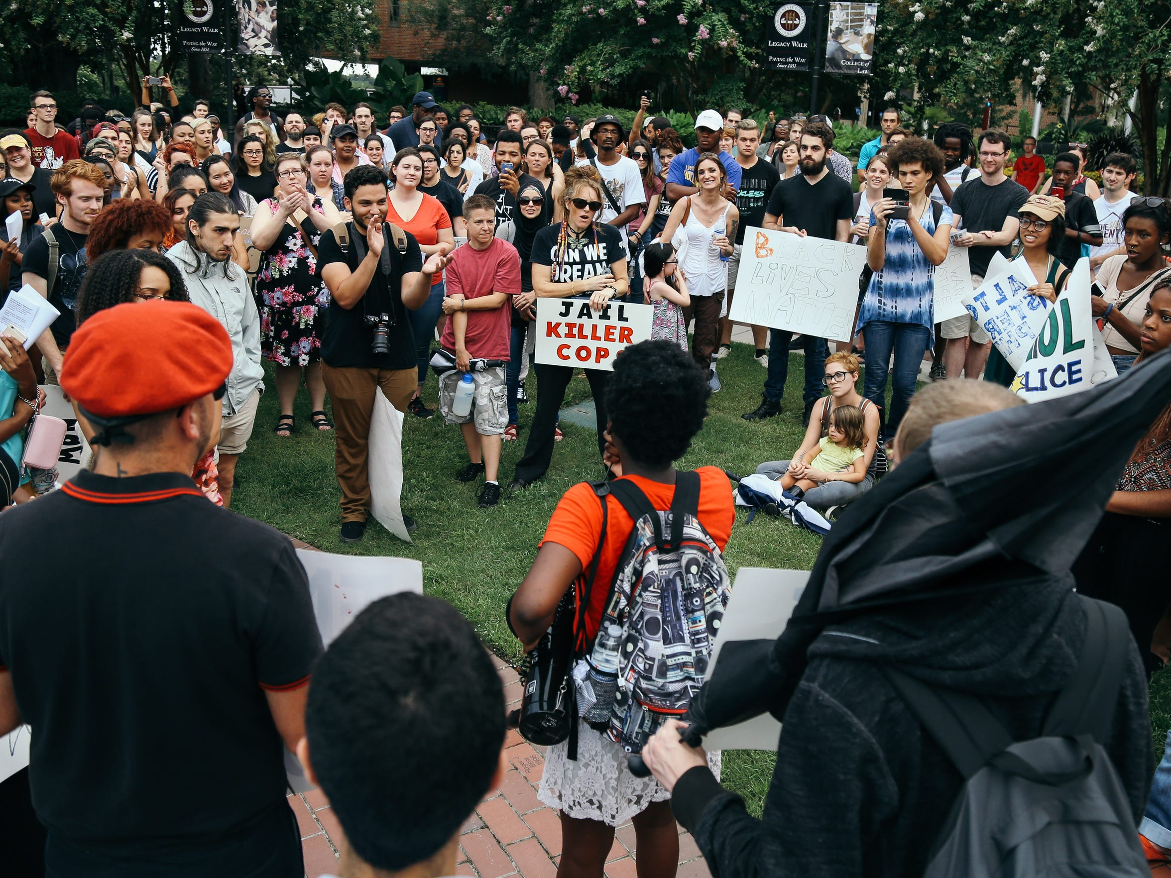 Students protest the shootings of Alton Sterling and Philando Castile on the campus of Florida State University on Tuesday, July 12, 2016.