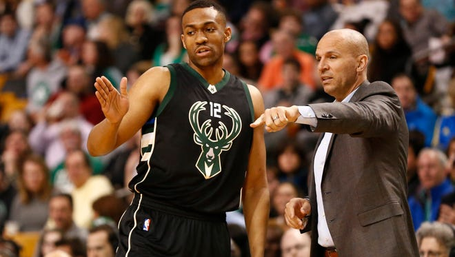 Jabari Parker and Jason Kidd converse on the sideline during a game in 2016.