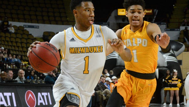 UW-Milwaukee guard Jeremiah Bell beats Valparaiso guard Micah Bradford along the baseline in a Horizon League basketball game Thursday, at the UW-Milwaukee Panther Arena.