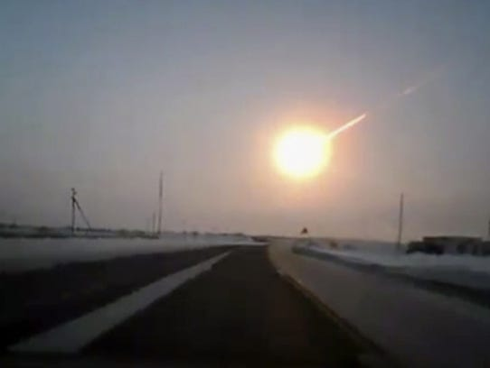 A meteorite contrail is seen in this frame-grab made