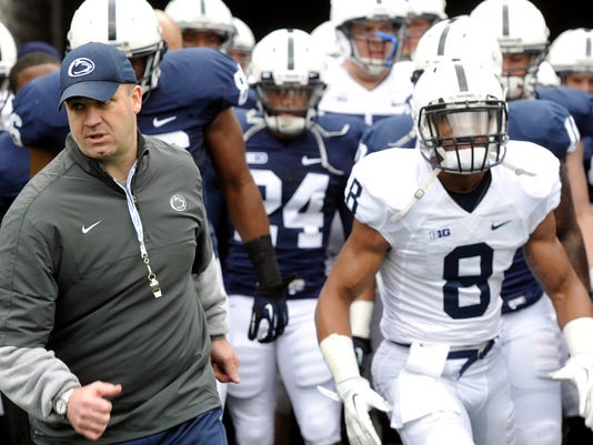 National Coach of the Year winner Bill O'Brien leads his team onto the field before the Blue-White Game.