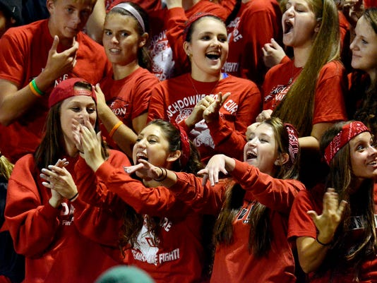 In this file photo, Dover High students show their school spirit during a Friday night football game against Central York.