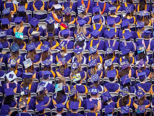 James Madison University graduating seniors show off a variety of cap decorations during the university's 2015 commencement ceremonies on May 8, 2015 in Harrisonburg.