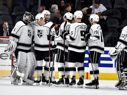 Los Angeles Kings right wing Dustin Brown (23) congratulates goalie Jack Campbell after the Kings defeated the Vegas Golden Knights 4-1 in an NHL hockey game Tuesday, Feb. 27, 2018, in Las Vegas.(AP Photo/David Becker)
