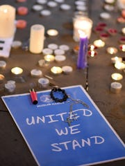 Members of the public attend a candlelit vigil May