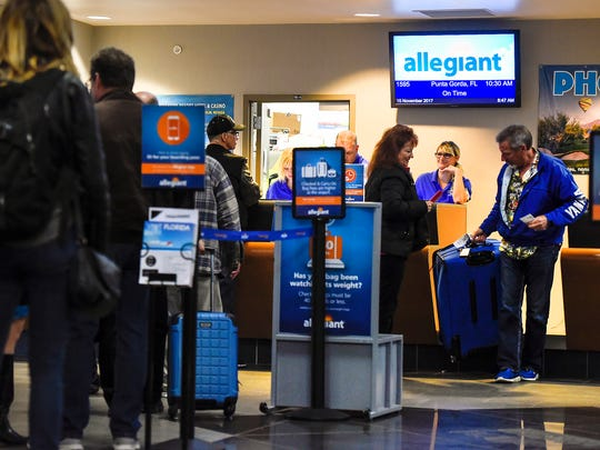 Passengers check in for the first Allegiant flight to Punta Gorda, Fla. Wednesday, Nov. 15, at the St. Cloud Regional Airport.