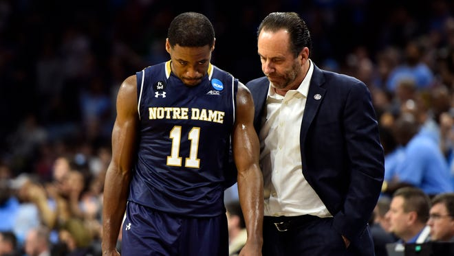 Mar 27, 2016; Philadelphia, PA, USA; Notre Dame Fighting Irish head coach Mike Brey reacts with guard Demetrius Jackson (11) after losing to the North Carolina Tar Heels in the championship game in the East regional of the NCAA Tournament at Wells Fargo Center. Carolina won 88-74. Mandatory Credit: Bob Donnan-USA TODAY Sports
